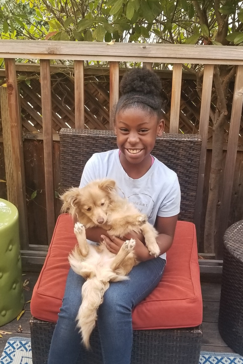 Young black girl and dog